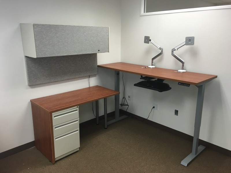 Cubicle with a standing desk